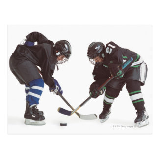 two caucasian hockey players wearing opposing postcard