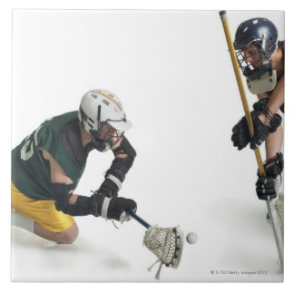 two caucasian male lacrosse players from 2 tile