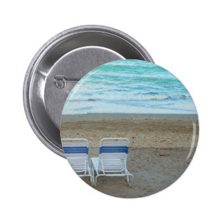 Two chairs on beach sand ocean waves pin
