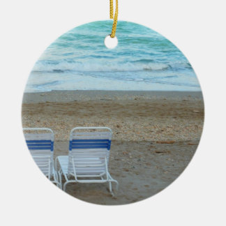 Two chairs on beach sand ocean waves Double-Sided ceramic round christmas ornament