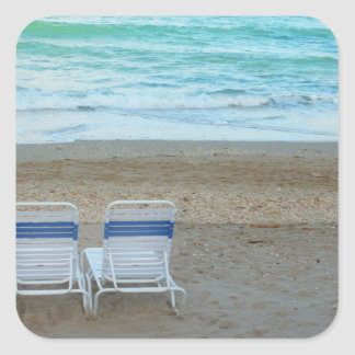 Two chairs on beach sand ocean waves sticker