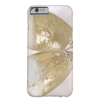 Two champagne flutes being filled with sparkling barely there iPhone 6 case