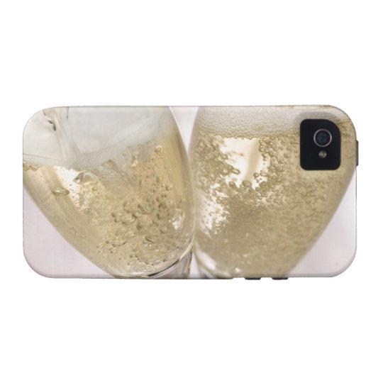 Two champagne flutes being filled with sparkling case for the iPhone 4