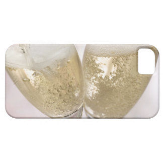 Two champagne flutes being filled with sparkling iPhone 5 cases