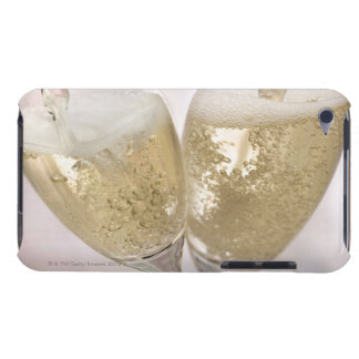 Two champagne flutes being filled with sparkling iPod Case-Mate cases