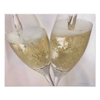 Two champagne flutes being filled with sparkling poster