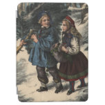 Two children collecting a Christmas tree and ivy iPad Air Cover