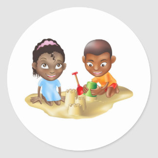 two children playing on the beach classic round sticker