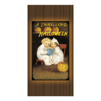 Two children reading ghost stories photo card