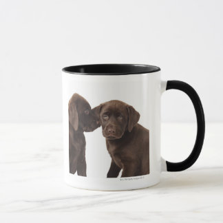 Two chocolate Labrador Retriever Puppies Mug