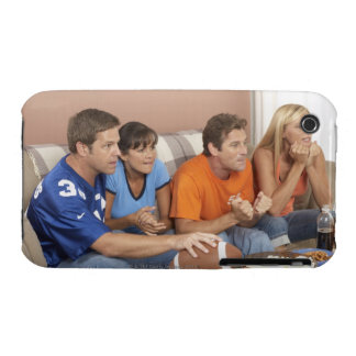 Two couples watching football in living room Case-Mate iPhone 3 cases