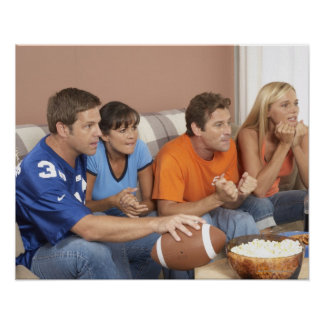Two couples watching football in living room poster
