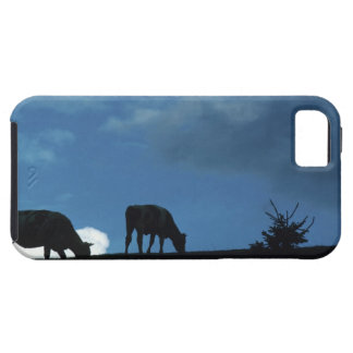 Two cows in silhouette grazing on hillside iPhone SE/5/5s case