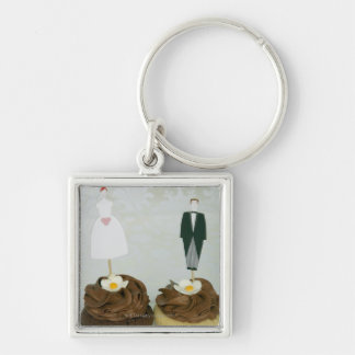 Two cupcakes with toy bride and groom on them keychain