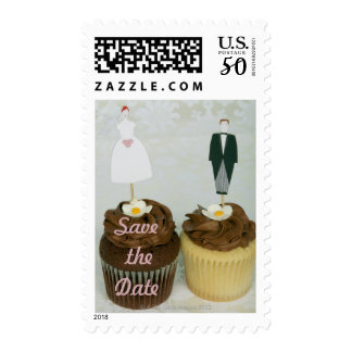 Two cupcakes with toy bride and groom on them postage