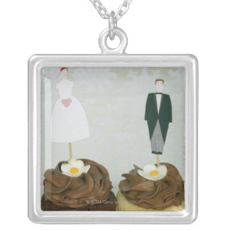 Two cupcakes with toy bride and groom on them square pendant necklace