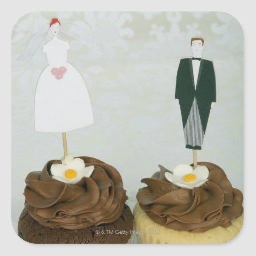 Two cupcakes with toy bride and groom on them square sticker