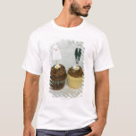 Two cupcakes with toy bride and groom on them T-Shirt
