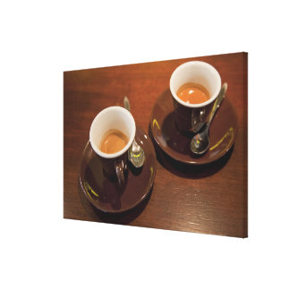 two cups of freshly brewed espresso coffee on a canvas print