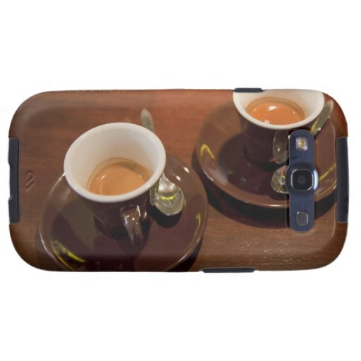 two cups of freshly brewed espresso coffee on a samsung galaxy s3 cover