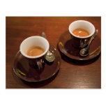 two cups of freshly brewed espresso coffee on a postcard