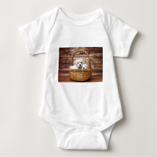 Two cute Maltese puppies sitting in a basket Baby Bodysuit