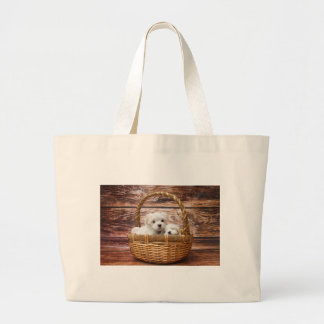 Two cute Maltese puppies sitting in a basket Large Tote Bag