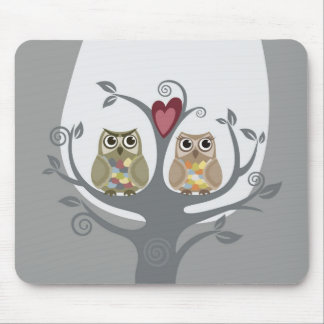 Two cute owls sitting in a love tree mouse mat