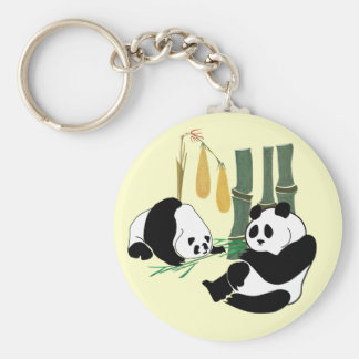 Two Cute Pandas eat bamboo in tropical forest Keychain