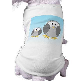 Two Cute Penguins. Cartoon on Sky Blue. Tee