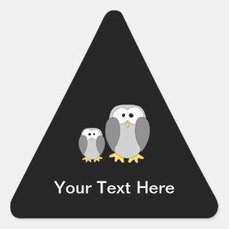 Two Cute Penguins. Cartoon. Triangle Sticker