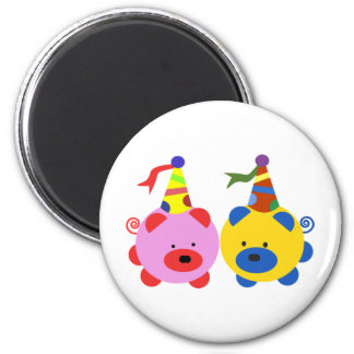 Two cute piggies at party time. 2 inch round magnet