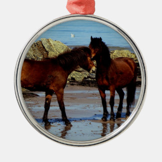 Two Dartmoor ponies on remote beach in south Devon Round Metal Christmas Ornament