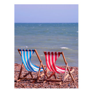 Two deckchairs on the beach postcard