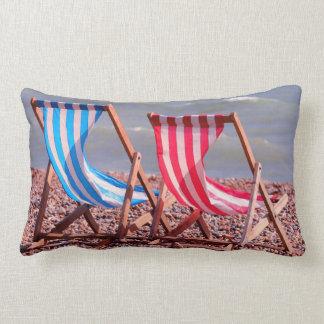 Two deckchairs on the beach throw pillows