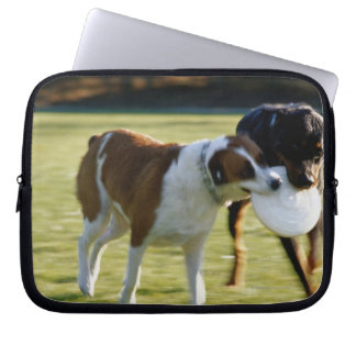 Two Dogs Fighting over Plastic Disc Laptop Sleeve