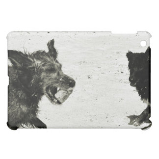 Two dogs playing on a beach. iPad mini covers
