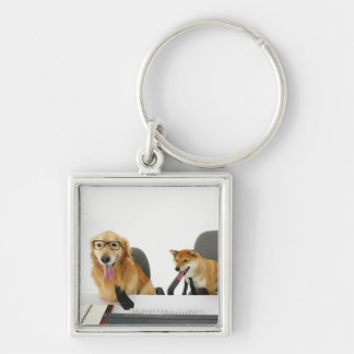 Two dogs wearing tie and glasses ,sitting on 2 keychain
