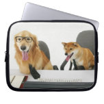 Two dogs wearing tie and glasses ,sitting on 2 laptop sleeves