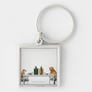 Two dogs wearing tie and glasses ,sitting on keychain