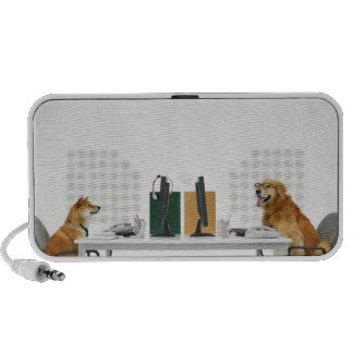 Two dogs wearing tie and glasses ,sitting on mini speaker