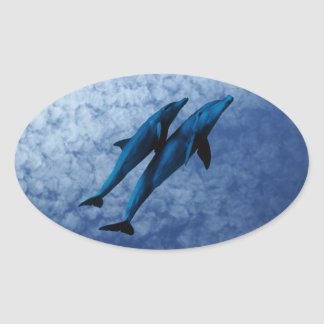 Two Dolphins Swiming at Sea Oval Sticker