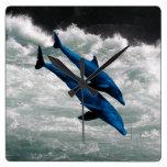 Two Dolphins Swiming at Sea Wall Clock