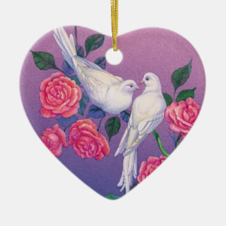 Two doves and flowers on a heart ornament