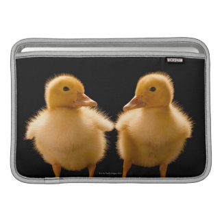 Two ducklings looking at one another MacBook sleeve