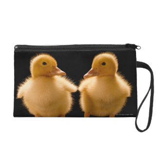 Two ducklings looking at one another wristlet