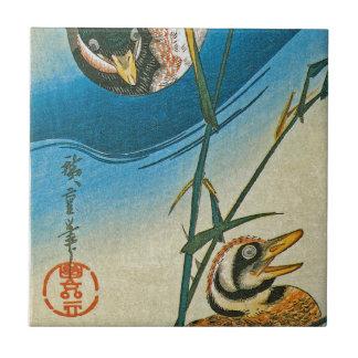 Two Ducks Swimming Among Reeds Ceramic Tile