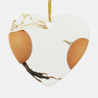 Two eggs as birds with beaks skull and legs ceramic ornament