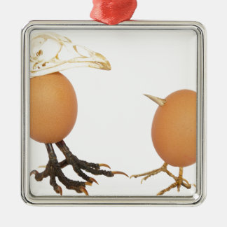 Two eggs as birds with beaks skull and legs metal ornament