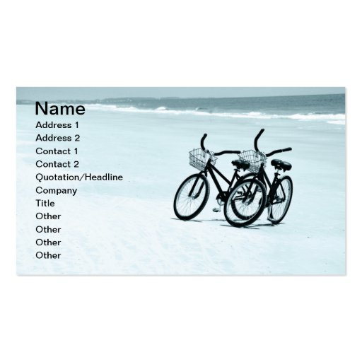 two empty touring bikes on a beach business card template